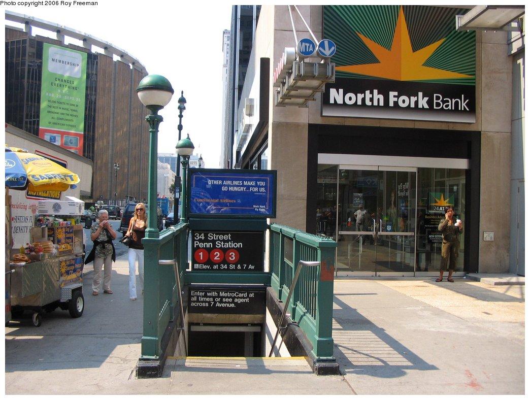 (175k, 1044x788)<br><b>Country:</b> United States<br><b>City:</b> New York<br><b>System:</b> New York City Transit<br><b>Line:</b> IRT West Side Line<br><b>Location:</b> 34th Street/Penn Station <br><b>Photo by:</b> Roy Freeman<br><b>Date:</b> 9/9/2006<br><b>Notes:</b> Station entrance n.w. corner 34th St. & 7th Ave. facing west.<br><b>Viewed (this week/total):</b> 0 / 3650