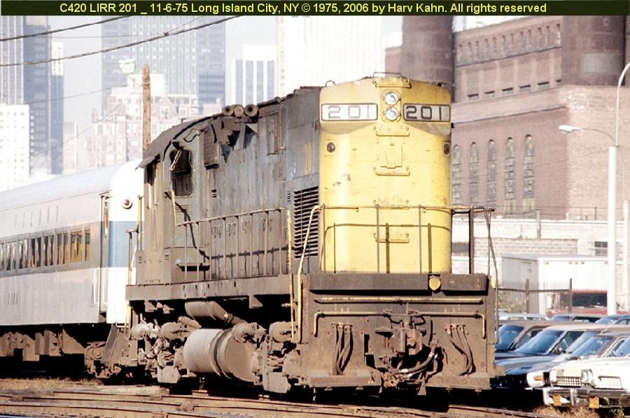 (102k, 900x598)<br><b>Country:</b> United States<br><b>City:</b> New York<br><b>System:</b> Long Island Rail Road<br><b>Line:</b> LIRR Long Island City<br><b>Location:</b> Long Island City <br><b>Car:</b> LIRR Alco C-420 (Diesel) 201 <br><b>Photo by:</b> Harv Kahn<br><b>Date:</b> 11/6/1975<br><b>Viewed (this week/total):</b> 5 / 1116