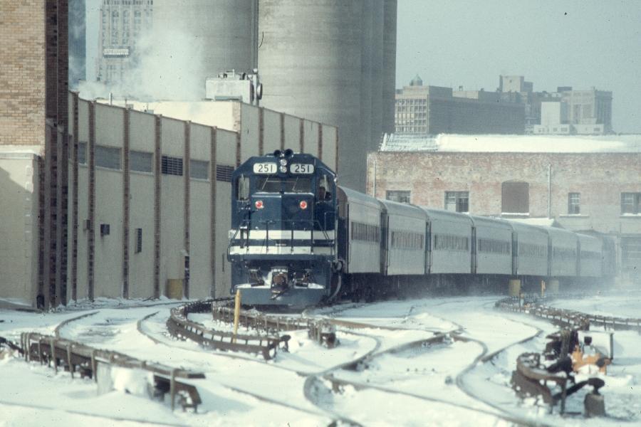 (70k, 900x600)<br><b>Country:</b> United States<br><b>City:</b> New York<br><b>System:</b> Long Island Rail Road<br><b>Line:</b> LIRR Long Island City<br><b>Location:</b> Long Island City <br><b>Car:</b> LIRR GP38-2 (Diesel) 251 <br><b>Photo by:</b> Harv Kahn<br><b>Date:</b> 2/2/1976<br><b>Viewed (this week/total):</b> 1 / 1652