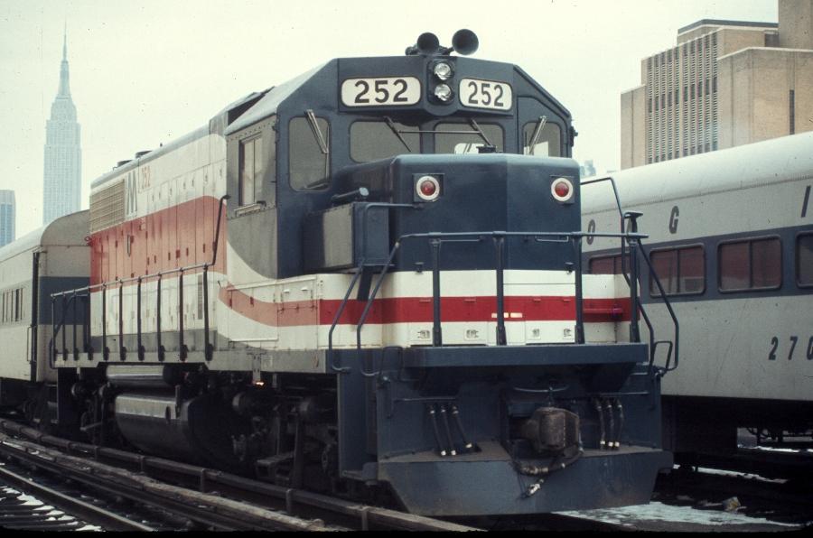 (67k, 900x596)<br><b>Country:</b> United States<br><b>City:</b> New York<br><b>System:</b> Long Island Rail Road<br><b>Line:</b> LIRR Long Island City<br><b>Location:</b> Long Island City <br><b>Car:</b> LIRR GP38-2 (Diesel) 252 <br><b>Photo by:</b> Harv Kahn<br><b>Date:</b> 2/5/1976<br><b>Viewed (this week/total):</b> 1 / 1234