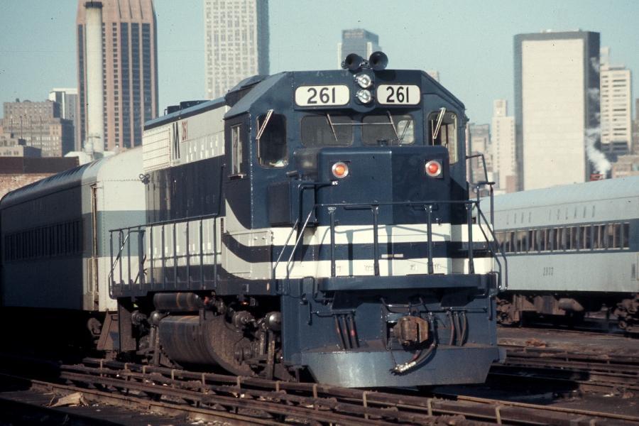 (79k, 900x600)<br><b>Country:</b> United States<br><b>City:</b> New York<br><b>System:</b> Long Island Rail Road<br><b>Line:</b> LIRR Long Island City<br><b>Location:</b> Long Island City <br><b>Car:</b> LIRR GP38-2 (Diesel) 261 <br><b>Photo by:</b> Harv Kahn<br><b>Date:</b> 2/23/1976<br><b>Viewed (this week/total):</b> 0 / 1112