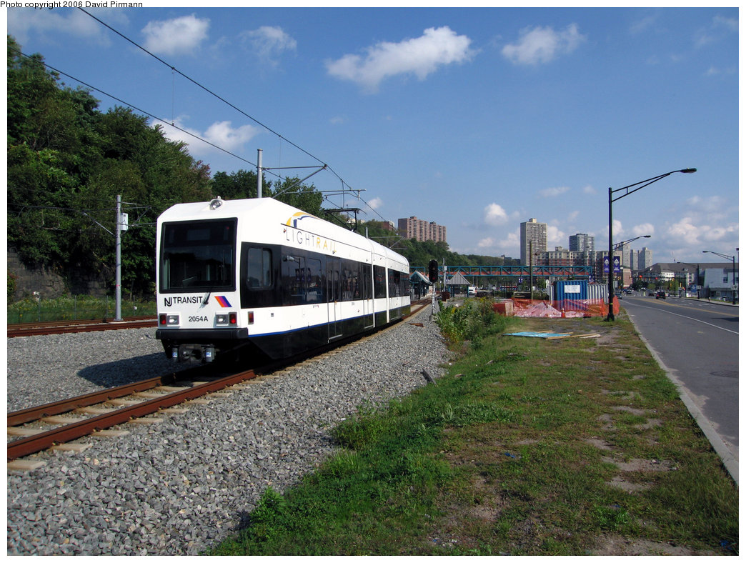 (288k, 1044x788)<br><b>Country:</b> United States<br><b>City:</b> Weehawken, NJ<br><b>System:</b> Hudson Bergen Light Rail<br><b>Location:</b> Port Imperial <br><b>Car:</b> NJT-HBLR LRV (Kinki-Sharyo, 1998-99)  2054 <br><b>Photo by:</b> David Pirmann<br><b>Date:</b> 9/28/2006<br><b>Viewed (this week/total):</b> 2 / 1793