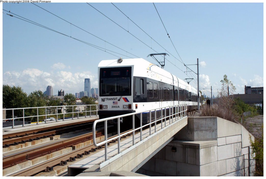 (197k, 1044x701)<br><b>Country:</b> United States<br><b>City:</b> Jersey City, NJ<br><b>System:</b> Hudson Bergen Light Rail<br><b>Location:</b> Garfield Avenue <br><b>Car:</b> NJT-HBLR LRV (Kinki-Sharyo, 1998-99)  2002 <br><b>Photo by:</b> David Pirmann<br><b>Date:</b> 9/28/2006<br><b>Viewed (this week/total):</b> 0 / 1796