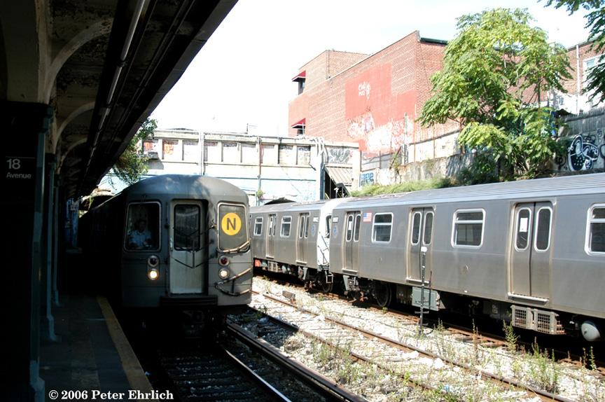 (246k, 864x574)<br><b>Country:</b> United States<br><b>City:</b> New York<br><b>System:</b> New York City Transit<br><b>Line:</b> BMT Sea Beach Line<br><b>Location:</b> 18th Avenue <br><b>Route:</b> N<br><b>Car:</b> R-68A (Kawasaki, 1988-1989)  5084 <br><b>Photo by:</b> Peter Ehrlich<br><b>Date:</b> 9/30/2006<br><b>Notes:</b> With R160 test train on the right.<br><b>Viewed (this week/total):</b> 0 / 2495