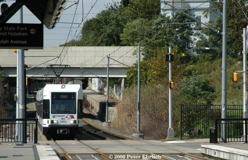 (270k, 864x556)<br><b>Country:</b> United States<br><b>City:</b> Jersey City, NJ<br><b>System:</b> Hudson Bergen Light Rail<br><b>Location:</b> Garfield Avenue <br><b>Car:</b> NJT-HBLR LRV (Kinki-Sharyo, 1998-99)  2006+2002 <br><b>Photo by:</b> Peter Ehrlich<br><b>Date:</b> 9/28/2006<br><b>Viewed (this week/total):</b> 0 / 1659