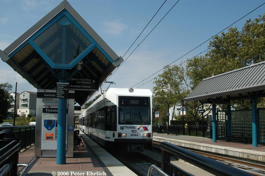 (214k, 864x574)<br><b>Country:</b> United States<br><b>City:</b> Jersey City, NJ<br><b>System:</b> Hudson Bergen Light Rail<br><b>Location:</b> Garfield Avenue <br><b>Car:</b> NJT-HBLR LRV (Kinki-Sharyo, 1998-99)  2006+2002 <br><b>Photo by:</b> Peter Ehrlich<br><b>Date:</b> 9/28/2006<br><b>Viewed (this week/total):</b> 0 / 1699