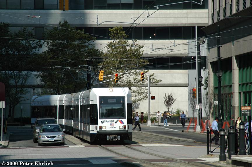 (222k, 864x574)<br><b>Country:</b> United States<br><b>City:</b> Jersey City, NJ<br><b>System:</b> Hudson Bergen Light Rail<br><b>Location:</b> Exchange Place <br><b>Car:</b> NJT-HBLR LRV (Kinki-Sharyo, 1998-99)  2015+2020 <br><b>Photo by:</b> Peter Ehrlich<br><b>Date:</b> 9/28/2006<br><b>Viewed (this week/total):</b> 0 / 1358