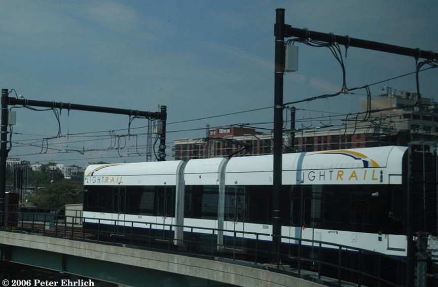 (147k, 864x566)<br><b>Country:</b> United States<br><b>City:</b> Jersey City, NJ<br><b>System:</b> Hudson Bergen Light Rail<br><b>Location:</b> Between Newport & Hoboken <br><b>Car:</b> NJT-HBLR LRV (Kinki-Sharyo, 1998-99)  2020 <br><b>Photo by:</b> Peter Ehrlich<br><b>Date:</b> 9/28/2006<br><b>Notes:</b> Second car of a 2-car train turning from Port Imperial line to main line.<br><b>Viewed (this week/total):</b> 0 / 1562