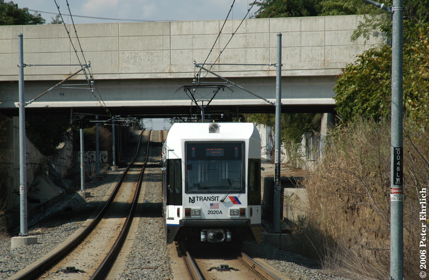 (236k, 864x563)<br><b>Country:</b> United States<br><b>City:</b> Jersey City, NJ<br><b>System:</b> Hudson Bergen Light Rail<br><b>Location:</b> Garfield Avenue <br><b>Car:</b> NJT-HBLR LRV (Kinki-Sharyo, 1998-99)  2020 <br><b>Photo by:</b> Peter Ehrlich<br><b>Date:</b> 9/28/2006<br><b>Viewed (this week/total):</b> 8 / 1536