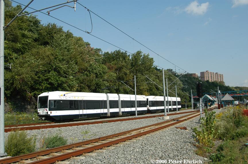 (260k, 864x574)<br><b>Country:</b> United States<br><b>City:</b> Weehawken, NJ<br><b>System:</b> Hudson Bergen Light Rail<br><b>Location:</b> Port Imperial <br><b>Car:</b> NJT-HBLR LRV (Kinki-Sharyo, 1998-99)  2023+2029 <br><b>Photo by:</b> Peter Ehrlich<br><b>Date:</b> 9/28/2006<br><b>Viewed (this week/total):</b> 0 / 1334