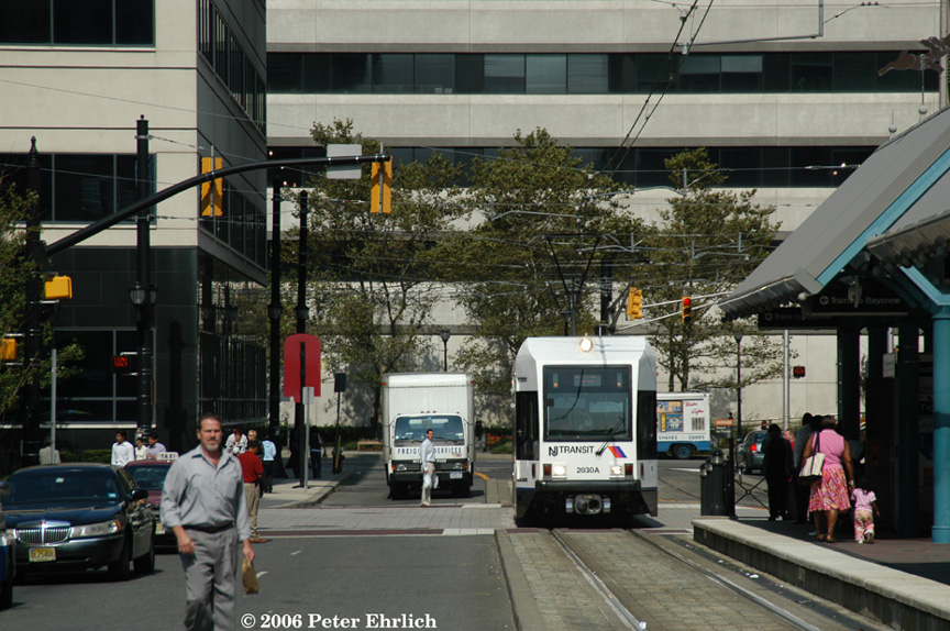 (221k, 864x574)<br><b>Country:</b> United States<br><b>City:</b> Jersey City, NJ<br><b>System:</b> Hudson Bergen Light Rail<br><b>Location:</b> Exchange Place <br><b>Car:</b> NJT-HBLR LRV (Kinki-Sharyo, 1998-99)  2030 <br><b>Photo by:</b> Peter Ehrlich<br><b>Date:</b> 9/28/2006<br><b>Viewed (this week/total):</b> 0 / 1400