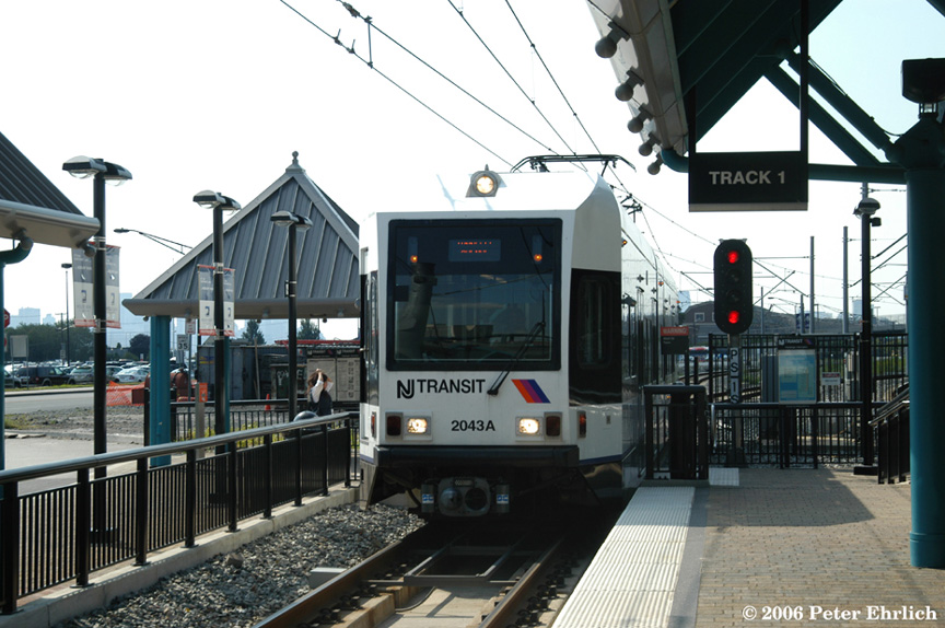 (195k, 864x574)<br><b>Country:</b> United States<br><b>City:</b> Weehawken, NJ<br><b>System:</b> Hudson Bergen Light Rail<br><b>Location:</b> Port Imperial <br><b>Car:</b> NJT-HBLR LRV (Kinki-Sharyo, 1998-99)  2043 <br><b>Photo by:</b> Peter Ehrlich<br><b>Date:</b> 9/28/2006<br><b>Viewed (this week/total):</b> 0 / 1360
