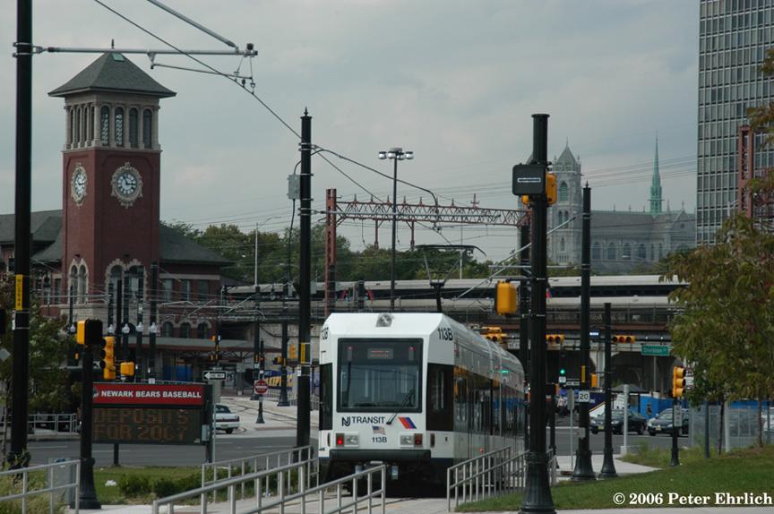 (195k, 864x574)<br><b>Country:</b> United States<br><b>City:</b> Newark, NJ<br><b>System:</b> Newark City Subway<br><b>Location:</b> Broad & Division <br><b>Car:</b> NJT Kinki-Sharyo LRV (Newark) 113 <br><b>Photo by:</b> Peter Ehrlich<br><b>Date:</b> 9/28/2006<br><b>Notes:</b> At Broad/Division Street outbound, trailing view.  Commuter train in background.<br><b>Viewed (this week/total):</b> 0 / 1796