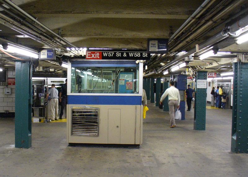 (150k, 800x573)<br><b>Country:</b> United States<br><b>City:</b> New York<br><b>System:</b> New York City Transit<br><b>Line:</b> IND 8th Avenue Line<br><b>Location:</b> 59th Street/Columbus Circle <br><b>Photo by:</b> Robbie Rosenfeld<br><b>Date:</b> 9/3/2006<br><b>Notes:</b> Reorganized mezzanine showing location of former bank of turnstiles (note signs on ceiling).<br><b>Viewed (this week/total):</b> 4 / 3048