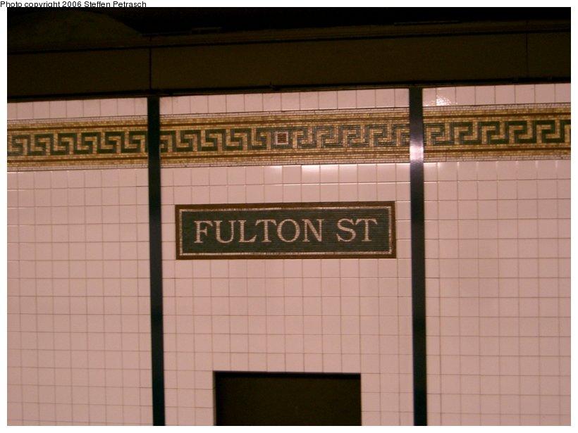(106k, 820x615)<br><b>Country:</b> United States<br><b>City:</b> New York<br><b>System:</b> New York City Transit<br><b>Line:</b> BMT Nassau Street/Jamaica Line<br><b>Location:</b> Fulton Street <br><b>Photo by:</b> Steffen Petrasch<br><b>Date:</b> 9/19/2006<br><b>Notes:</b> Name tablet.<br><b>Viewed (this week/total):</b> 0 / 1876