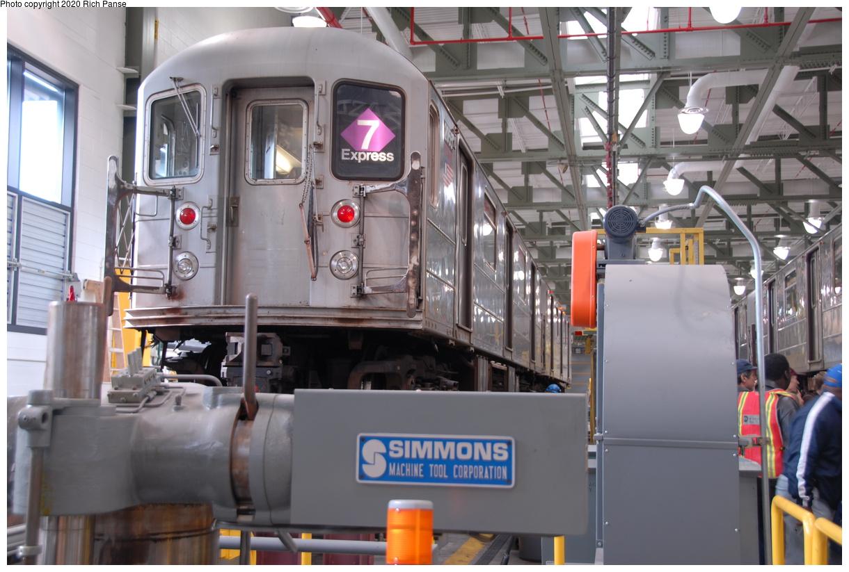 (190k, 1044x705)<br><b>Country:</b> United States<br><b>City:</b> New York<br><b>System:</b> New York City Transit<br><b>Location:</b> Corona Shops<br><b>Car:</b> R-62A (Bombardier, 1984-1987)  2055 <br><b>Photo by:</b> Richard Panse<br><b>Date:</b> 10/22/2006<br><b>Notes:</b> R62A on the wheel truing machine in new Corona shop.<br><b>Viewed (this week/total):</b> 0 / 3165