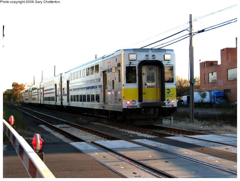 (143k, 820x620)<br><b>Country:</b> United States<br><b>City:</b> New York<br><b>System:</b> Long Island Rail Road<br><b>Line:</b> LIRR Long Island City<br><b>Location:</b> Maspeth Avenue <br><b>Car:</b> LIRR Kawasaki C-3/C-R (Bilevel Coach/Cab) 5007 <br><b>Photo by:</b> Gary Chatterton<br><b>Date:</b> 10/26/2006<br><b>Viewed (this week/total):</b> 3 / 2201