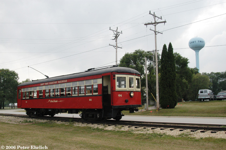(178k, 864x574)<br><b>Country:</b> United States<br><b>City:</b> East Troy, WI<br><b>System:</b> East Troy Electric Railroad Museum <br><b>Car:</b> PSTC/SEPTA Strafford (J.G. Brill Co., 1927-1929)  64 (ex-164)<br><b>Photo by:</b> Peter Ehrlich<br><b>Date:</b> 8/28/2006<br><b>Notes:</b> Along the Industrial Spur on the east side of town.<br><b>Viewed (this week/total):</b> 2 / 2232