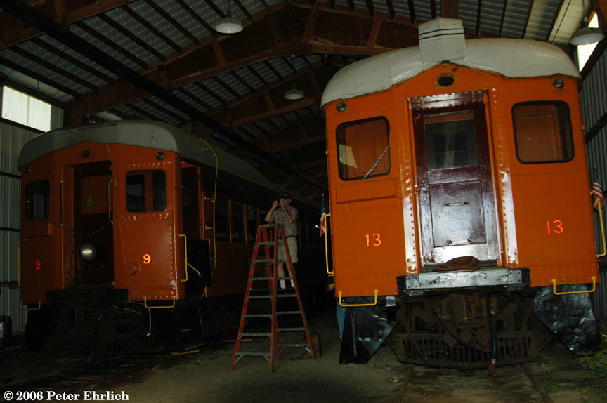 (178k, 864x574)<br><b>Country:</b> United States<br><b>City:</b> East Troy, WI<br><b>System:</b> East Troy Electric Railroad Museum <br><b>Car:</b>  9/13 <br><b>Photo by:</b> Peter Ehrlich<br><b>Date:</b> 7/31/2004<br><b>Notes:</b> South Shore cars 9 and 13 inside Phantom Woods Carhouse.<br><b>Viewed (this week/total):</b> 2 / 2048