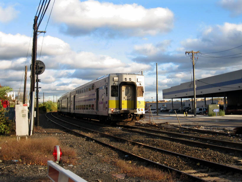 (117k, 820x615)<br><b>Country:</b> United States<br><b>City:</b> New York<br><b>System:</b> Long Island Rail Road<br><b>Line:</b> LIRR Long Island City<br><b>Location:</b> 43rd Street nr 56th Rd. <br><b>Car:</b> LIRR Kawasaki C-3/C-R (Bilevel Coach/Cab) 5017 <br><b>Photo by:</b> Gary Chatterton<br><b>Date:</b> 10/20/2006<br><b>Viewed (this week/total):</b> 0 / 1630