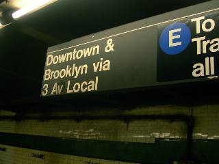 (119k, 320x240)<br><b>Country:</b> United States<br><b>City:</b> New York<br><b>System:</b> New York City Transit<br><b>Line:</b> IND 8th Avenue Line<br><b>Location:</b> West 4th Street/Washington Square <br><b>Photo by:</b> Mike Jiran<br><b>Date:</b> 10/8/2006<br><b>Notes:</b> Sign indicating 3 Av local on the 8th Ave. platform at West 4th. Close inspection shows the 3 wasn't an 8 changed as a prank, the 3 is as old as the sign itself. The other half of the sign has been pasted over enough times to suggest that at the very least it predates 9/11/01, because you can see where it temporarily said To Canal Street, all times while the WTC portion of Chambers was shut down.<br><b>Viewed (this week/total):</b> 2 / 2487