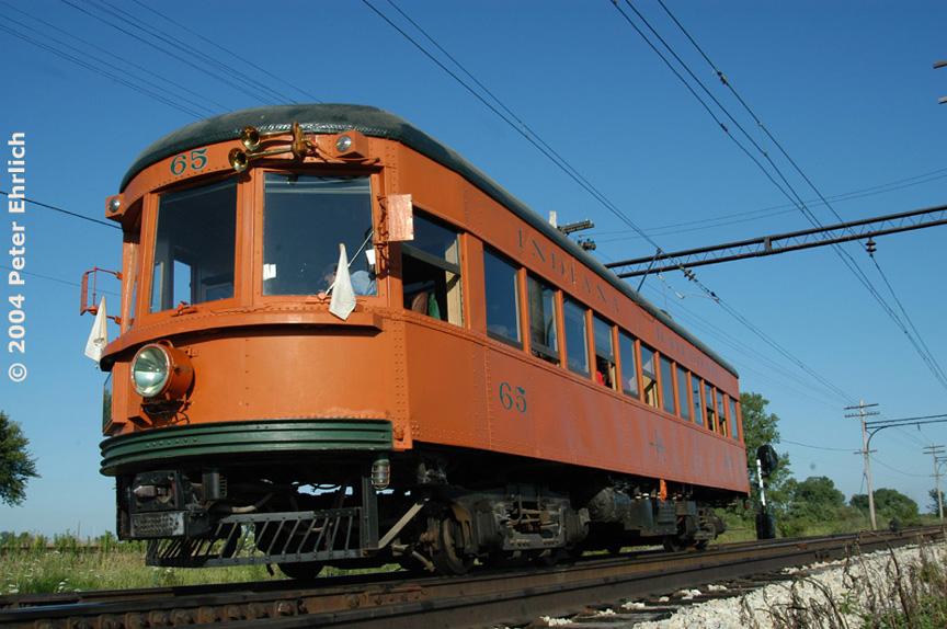 (201k, 864x574)<br><b>Country:</b> United States<br><b>City:</b> Union, IL<br><b>System:</b> Illinois Railway Museum <br><b>Car:</b>  65 <br><b>Photo by:</b> Peter Ehrlich<br><b>Date:</b> 7/31/2004<br><b>Notes:</b> Indiana Railroad Indiana High-Speed 65 at Seeman Road siding.<br><b>Viewed (this week/total):</b> 2 / 1499