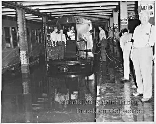 (110k, 500x399)<br><b>Country:</b> United States<br><b>City:</b> New York<br><b>System:</b> New York City Transit<br><b>Line:</b> IND Crosstown Line<br><b>Location:</b> Metropolitan Avenue/Grand Street <br><b>Collection of:</b> Brooklyn Public Library (via Herbert Maruska)<br><b>Notes:</b> Flood at Metropolitan Ave. 1950s.<br><b>Viewed (this week/total):</b> 7 / 4583