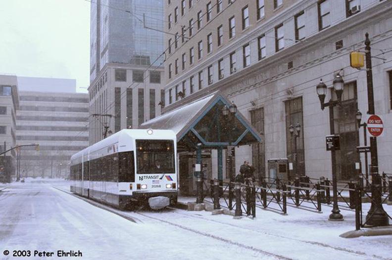 (157k, 792x526)<br><b>Country:</b> United States<br><b>City:</b> Jersey City, NJ<br><b>System:</b> Hudson Bergen Light Rail<br><b>Location:</b> Exchange Place <br><b>Car:</b> NJT-HBLR LRV (Kinki-Sharyo, 1998-99)  2026 <br><b>Photo by:</b> Peter Ehrlich<br><b>Date:</b> 3/6/2003<br><b>Notes:</b> Exchange Place Station southbound.<br><b>Viewed (this week/total):</b> 2 / 1472