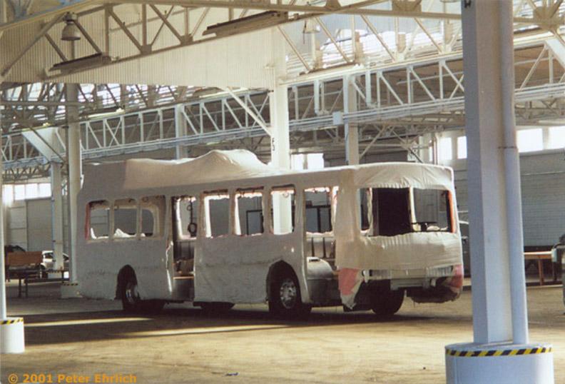 (162k, 792x538)<br><b>Country:</b> United States<br><b>City:</b> San Francisco/Bay Area, CA<br><b>System:</b> SF MUNI<br><b>Line:</b> SF MUNI Trolley Coach Routes<br><b>Car:</b> SF MUNI Trolley Coach (ETI 14Tr-SF 40ft., 2001-03) 5403 <br><b>Photo by:</b> Peter Ehrlich<br><b>Date:</b> 1/15/2001<br><b>Notes:</b> Shell of first production ETI coach at their Pier 15 assembly facility.<br><b>Viewed (this week/total):</b> 2 / 1996