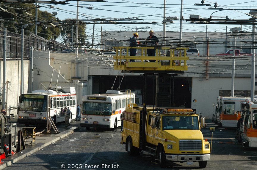 (235k, 864x574)<br><b>Country:</b> United States<br><b>City:</b> San Francisco/Bay Area, CA<br><b>System:</b> SF MUNI<br><b>Line:</b> SF MUNI Trolley Coach Routes<br><b>Car:</b> SF MUNI Trolley Coach (ETI 14Tr-SF 40ft., 2001-03) 5413 <br><b>Photo by:</b> Peter Ehrlich<br><b>Date:</b> 11/21/2005<br><b>Notes:</b> Potrero Division, with Flyer 5312 and overhead line truck.<br><b>Viewed (this week/total):</b> 0 / 1396