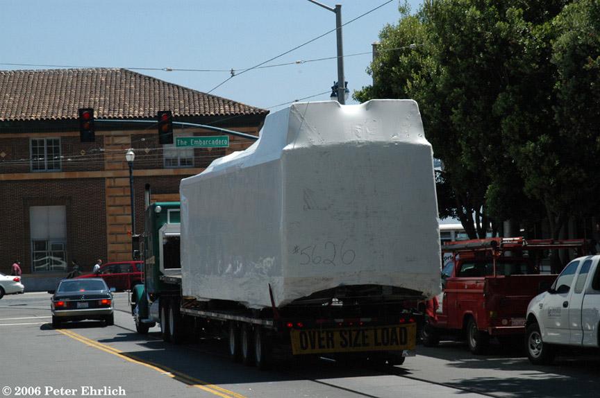 (187k, 864x574)<br><b>Country:</b> United States<br><b>City:</b> San Francisco/Bay Area, CA<br><b>System:</b> SF MUNI<br><b>Line:</b> SF MUNI Trolley Coach Routes<br><b>Car:</b> SF MUNI Trolley Coach (ETI 14Tr-SF 40ft., 2001-03) 5626 <br><b>Photo by:</b> Peter Ehrlich<br><b>Date:</b> 7/1/2003<br><b>Notes:</b> New body shell arriving San Francisco on flatbed trailer. Mission/Embarcadero, enroute to Pier 15.<br><b>Viewed (this week/total):</b> 0 / 1131