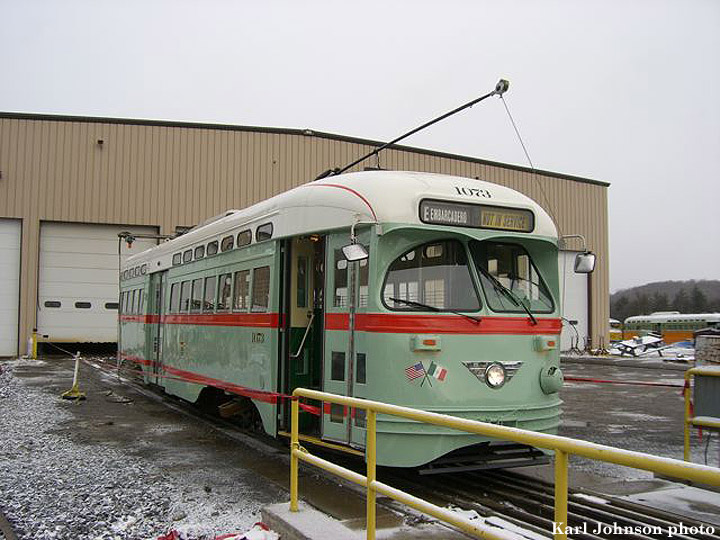 (162k, 720x540)<br><b>Country:</b> United States<br><b>City:</b> Brookville, PA<br><b>System:</b> Brookville Equipment<br><b>Car:</b> SF MUNI PCC (Ex-NJTransit, Ex-Twin City) (St. Louis Car Co., 1946-1947)  1073 <br><b>Photo by:</b> Karl Johnson<br><b>Collection of:</b> Peter Ehrlich<br><b>Date:</b> 12/8/2006<br><b>Notes:</b> Muni ex-Newark PCC 1073 (El Paso City Lines livery) at Brookville Equipment Co. in Brookvile, Pennsylvania, ready for delivery.  It's due to arrive in San Francisco sometime the week of Dec. 18.<br><b>Viewed (this week/total):</b> 0 / 2611
