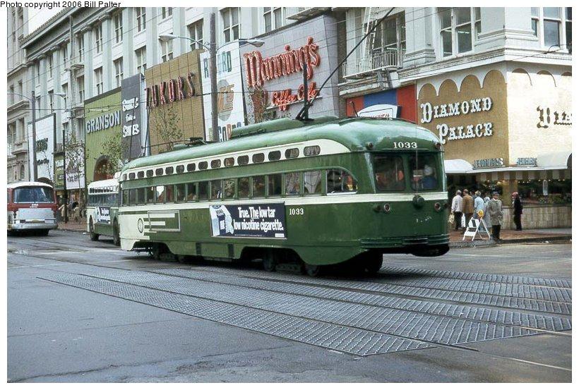 (138k, 820x553)<br><b>Country:</b> United States<br><b>City:</b> San Francisco/Bay Area, CA<br><b>System:</b> SF MUNI<br><b>Location:</b> Market/5th <br><b>Car:</b> SF MUNI PCC Baby Ten (St. Louis Car Co, 1951)  1033 <br><b>Photo by:</b> Kenneth Palter<br><b>Collection of:</b> Bill Palter<br><b>Date:</b> 12/1973<br><b>Viewed (this week/total):</b> 1 / 1197