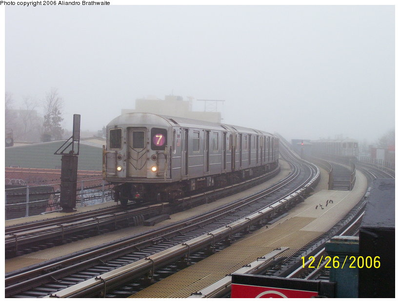 (100k, 820x620)<br><b>Country:</b> United States<br><b>City:</b> New York<br><b>System:</b> New York City Transit<br><b>Line:</b> IRT Flushing Line<br><b>Location:</b> 103rd Street/Corona Plaza <br><b>Route:</b> 7<br><b>Car:</b> R-62A (Bombardier, 1984-1987)  1656 <br><b>Photo by:</b> Aliandro Brathwaite<br><b>Date:</b> 12/26/2006<br><b>Viewed (this week/total):</b> 0 / 2538