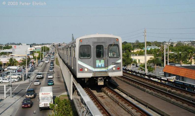 (152k, 792x471)<br><b>Country:</b> United States<br><b>City:</b> Miami, FL<br><b>System:</b> Miami Metrorail<br><b>Location:</b> Tri-Rail <br><b>Car:</b>  212 <br><b>Photo by:</b> Peter Ehrlich<br><b>Date:</b> 4/25/2003<br><b>Notes:</b> Approaching Tri-Rail/MetroRail Station northbound.<br><b>Viewed (this week/total):</b> 0 / 2590