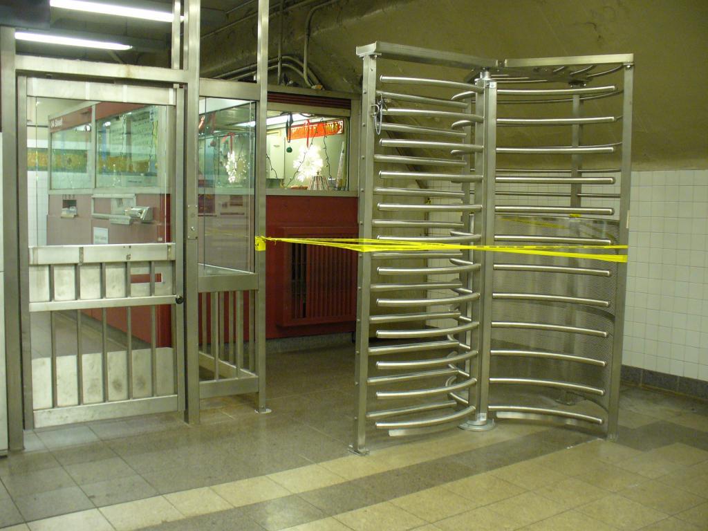 (130k, 1024x768)<br><b>Country:</b> United States<br><b>City:</b> New York<br><b>System:</b> New York City Transit<br><b>Line:</b> IRT West Side Line<br><b>Location:</b> 34th Street/Penn Station <br><b>Photo by:</b> Robbie Rosenfeld<br><b>Date:</b> 12/19/2006<br><b>Notes:</b> Fare control reorganization at Penn Sta. has this high exit turnstile off by itself.<br><b>Viewed (this week/total):</b> 0 / 2748