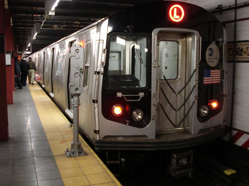 (110k, 1037x778)<br><b>Country:</b> United States<br><b>City:</b> New York<br><b>System:</b> New York City Transit<br><b>Line:</b> BMT Canarsie Line<br><b>Location:</b> 8th Avenue <br><b>Route:</b> L<br><b>Car:</b> R-143 (Kawasaki, 2001-2002) 8297 <br><b>Photo by:</b> Michael Hodurski<br><b>Date:</b> 12/29/2006<br><b>Viewed (this week/total):</b> 2 / 2744