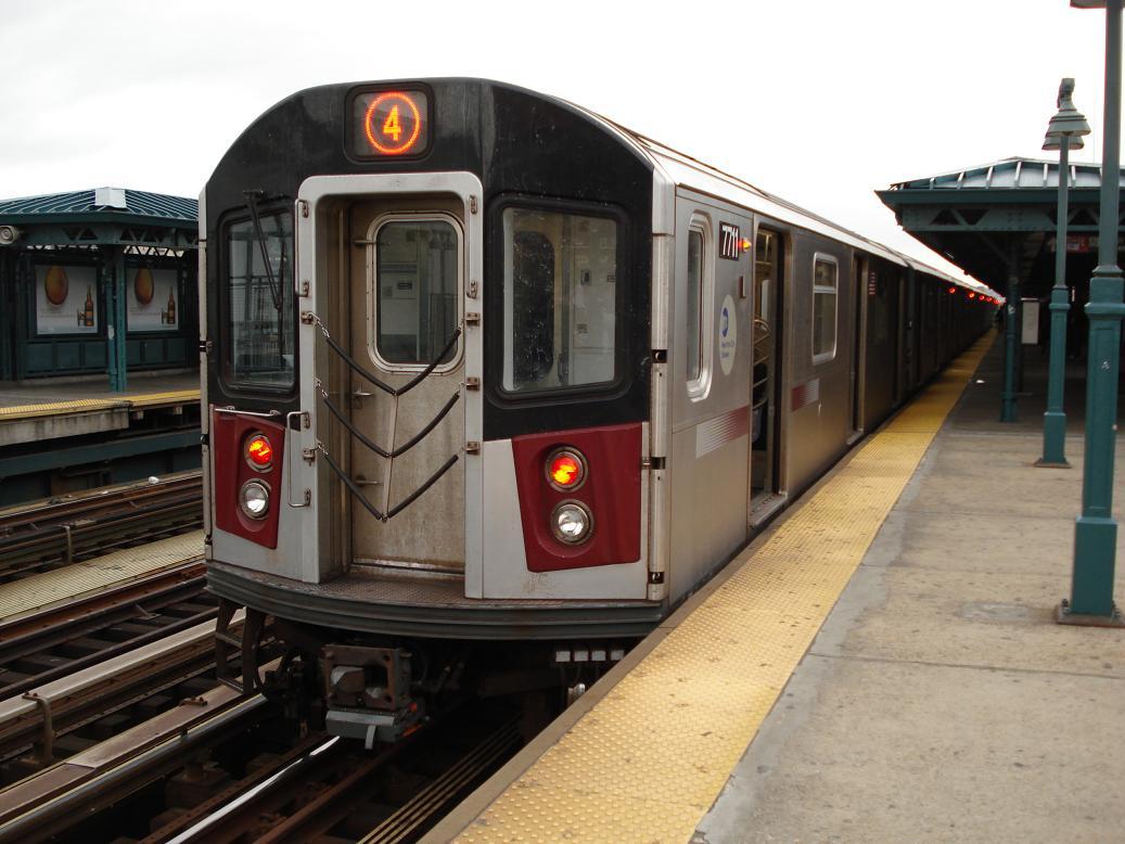 (122k, 1037x778)<br><b>Country:</b> United States<br><b>City:</b> New York<br><b>System:</b> New York City Transit<br><b>Line:</b> IRT Woodlawn Line<br><b>Location:</b> 161st Street/River Avenue (Yankee Stadium) <br><b>Route:</b> 4<br><b>Car:</b> R-142A (Option Order, Kawasaki, 2002-2003)  7711 <br><b>Photo by:</b> Michael Hodurski<br><b>Date:</b> 12/29/2006<br><b>Viewed (this week/total):</b> 0 / 3111