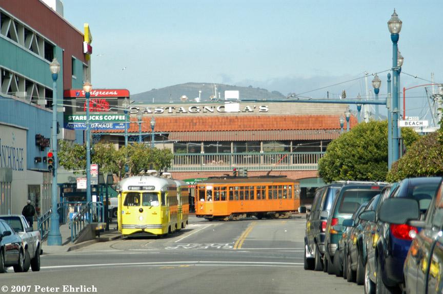 (208k, 864x574)<br><b>Country:</b> United States<br><b>City:</b> San Francisco/Bay Area, CA<br><b>System:</b> SF MUNI<br><b>Location:</b> Jones/Beach <br><b>Car:</b> SF MUNI PCC (Ex-SEPTA) (St. Louis Car Co., 1947-1948)  1063/1057 <br><b>Photo by:</b> Peter Ehrlich<br><b>Date:</b> 1/10/2007<br><b>Notes:</b> Baltimore, Cincinnati livery PCC cars, viewed from Jones/North Point. With Milan 1915 arriving terminal.<br><b>Viewed (this week/total):</b> 0 / 709