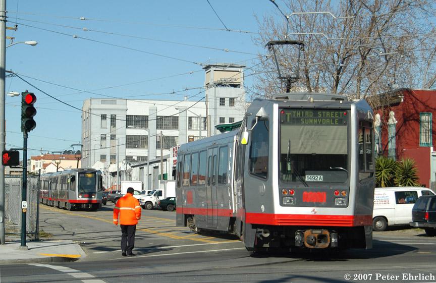 (215k, 864x561)<br><b>Country:</b> United States<br><b>City:</b> San Francisco/Bay Area, CA<br><b>System:</b> SF MUNI<br><b>Line:</b> MUNI 3rd Street Light Rail<br><b>Location:</b> 3rd Street/Armstrong Ave. Wye <br><b>Car:</b> SF MUNI Breda LRV 1492 <br><b>Photo by:</b> Peter Ehrlich<br><b>Date:</b> 1/15/2007<br><b>Notes:</b> LRV wyeing at Armstrong Avenue Wye, with 1413/1528 in background.<br><b>Viewed (this week/total):</b> 0 / 1318