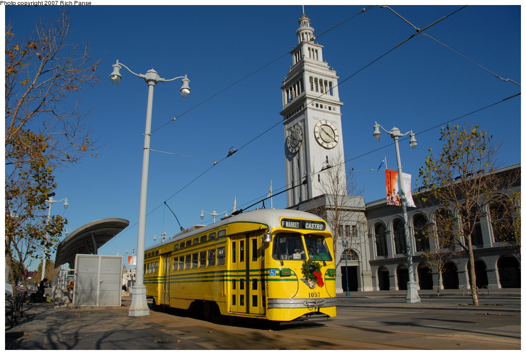 (204k, 1044x705)<br><b>Country:</b> United States<br><b>City:</b> San Francisco/Bay Area, CA<br><b>System:</b> SF MUNI<br><b>Location:</b> Embarcadero/Ferry Building <br><b>Car:</b> SF MUNI PCC (Ex-SEPTA) (St. Louis Car Co., 1947-1948)  1057 <br><b>Photo by:</b> Richard Panse<br><b>Date:</b> 12/17/2006<br><b>Viewed (this week/total):</b> 1 / 792