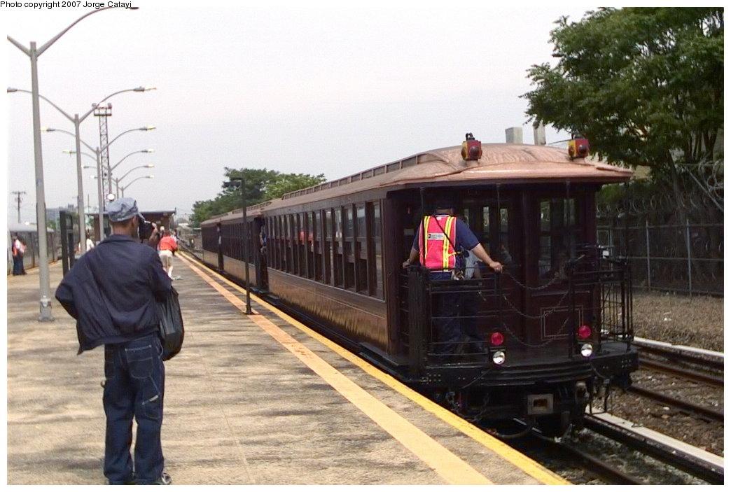 (146k, 1044x703)<br><b>Country:</b> United States<br><b>City:</b> New York<br><b>System:</b> New York City Transit<br><b>Line:</b> IND Rockaway<br><b>Location:</b> Rockaway Park/Beach 116th Street <br><b>Route:</b> Fan Trip<br><b>Car:</b> BMT Elevated Gate Car 1404-1273-1407 <br><b>Photo by:</b> Jorge Catayi<br><b>Date:</b> 6/17/2006<br><b>Viewed (this week/total):</b> 1 / 1818