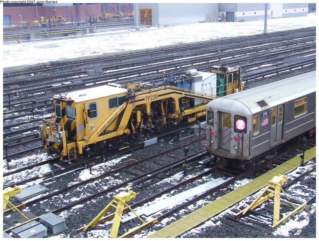 (303k, 1044x788)<br><b>Country:</b> United States<br><b>City:</b> New York<br><b>System:</b> New York City Transit<br><b>Location:</b> Corona Yard<br><b>Car:</b> R-62A (Bombardier, 1984-1987)  2112 <br><b>Photo by:</b> John Barnes<br><b>Date:</b> 2/27/2007<br><b>Notes:</b> With Ballast Tamper TP236<br><b>Viewed (this week/total):</b> 1 / 1550