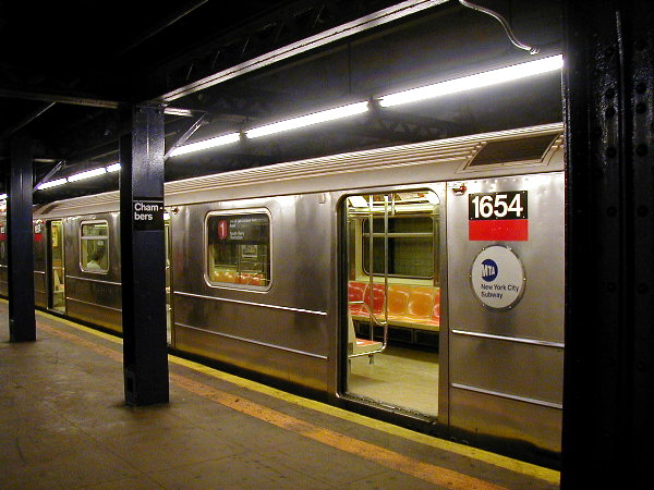 (80k, 600x450)<br><b>Country:</b> United States<br><b>City:</b> New York<br><b>System:</b> New York City Transit<br><b>Line:</b> IRT West Side Line<br><b>Location:</b> Chambers Street <br><b>Route:</b> 1<br><b>Car:</b> R-62A (Bombardier, 1984-1987)  1654 <br><b>Photo by:</b> Trevor Logan<br><b>Date:</b> 6/10/2001<br><b>Viewed (this week/total):</b> 5 / 8452