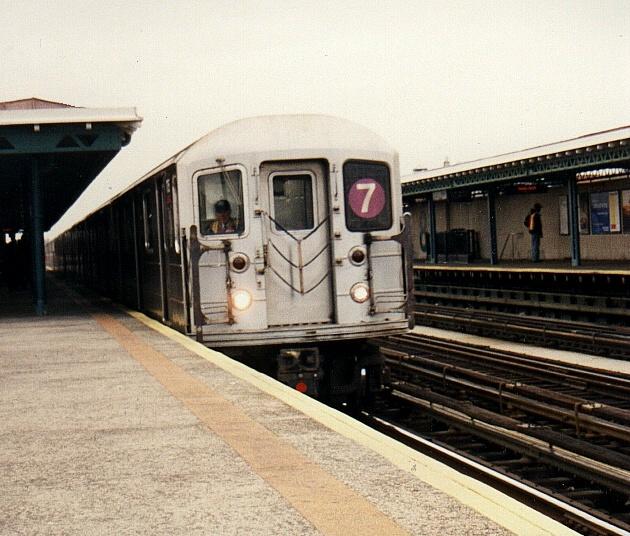 (170k, 630x536)<br><b>Country:</b> United States<br><b>City:</b> New York<br><b>System:</b> New York City Transit<br><b>Line:</b> IRT Flushing Line<br><b>Location:</b> 82nd Street/Jackson Heights <br><b>Route:</b> 7<br><b>Car:</b> R-62A (Bombardier, 1984-1987)  1705 <br><b>Photo by:</b> Gary Chatterton<br><b>Date:</b> 2002<br><b>Viewed (this week/total):</b> 0 / 2809