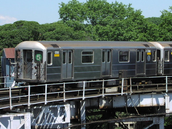 (98k, 600x450)<br><b>Country:</b> United States<br><b>City:</b> New York<br><b>System:</b> New York City Transit<br><b>Line:</b> IRT White Plains Road Line<br><b>Location:</b> West Farms Sq./East Tremont Ave./177th St. <br><b>Route:</b> 5<br><b>Car:</b> R-62A (Bombardier, 1984-1987)  1705 <br><b>Photo by:</b> Trevor Logan<br><b>Date:</b> 9/2001<br><b>Viewed (this week/total):</b> 2 / 6811