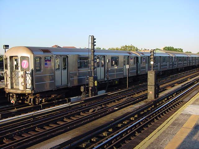 (60k, 640x480)<br><b>Country:</b> United States<br><b>City:</b> New York<br><b>System:</b> New York City Transit<br><b>Line:</b> IRT Flushing Line<br><b>Location:</b> 69th Street/Fisk Avenue <br><b>Route:</b> 7<br><b>Car:</b> R-62A (Bombardier, 1984-1987)  2115 <br><b>Photo by:</b> Salaam Allah<br><b>Date:</b> 9/17/2002<br><b>Viewed (this week/total):</b> 2 / 2614