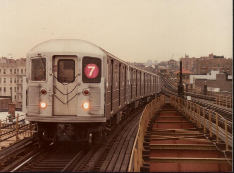 (51k, 800x591)<br><b>Country:</b> United States<br><b>City:</b> New York<br><b>System:</b> New York City Transit<br><b>Line:</b> IRT Flushing Line<br><b>Location:</b> 61st Street/Woodside <br><b>Route:</b> 7<br><b>Car:</b> R-62A (Bombardier, 1984-1987)   <br><b>Photo by:</b> Phil Hom<br><b>Notes:</b> Testing in mid 1980s<br><b>Viewed (this week/total):</b> 1 / 5435