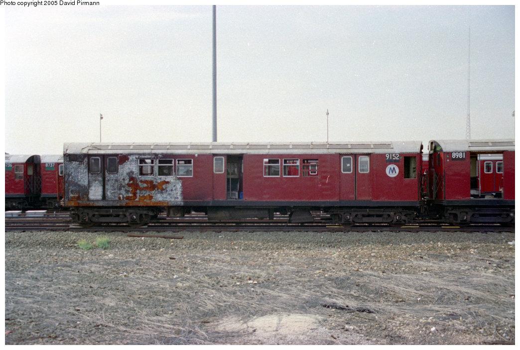 (185k, 1044x703)<br><b>Country:</b> United States<br><b>City:</b> New York<br><b>System:</b> New York City Transit<br><b>Location:</b> 239th Street Yard<br><b>Car:</b> R-33 Main Line (St. Louis, 1962-63) 9152 <br><b>Photo by:</b> David Pirmann<br><b>Date:</b> 9/13/1998<br><b>Notes:</b> R33 9152 coupled to 8981-fire damage from 2/3/1998 accident<br><b>Viewed (this week/total):</b> 3 / 12628