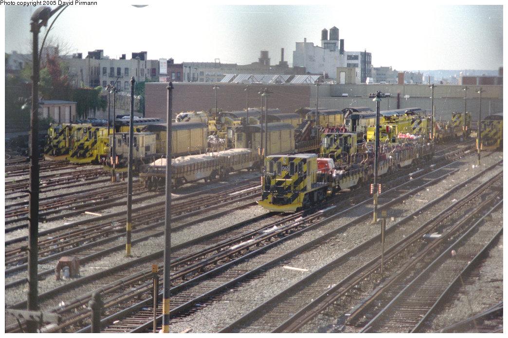 (245k, 1044x695)<br><b>Country:</b> United States<br><b>City:</b> New York<br><b>System:</b> New York City Transit<br><b>Location:</b> 36th Street Yard<br><b>Car:</b> R-47 Locomotive  65 <br><b>Photo by:</b> David Pirmann<br><b>Date:</b> 10/11/1996<br><b>Notes:</b> Other locomotives visible include 903, 82, 62, 907, and 74.<br><b>Viewed (this week/total):</b> 0 / 4111